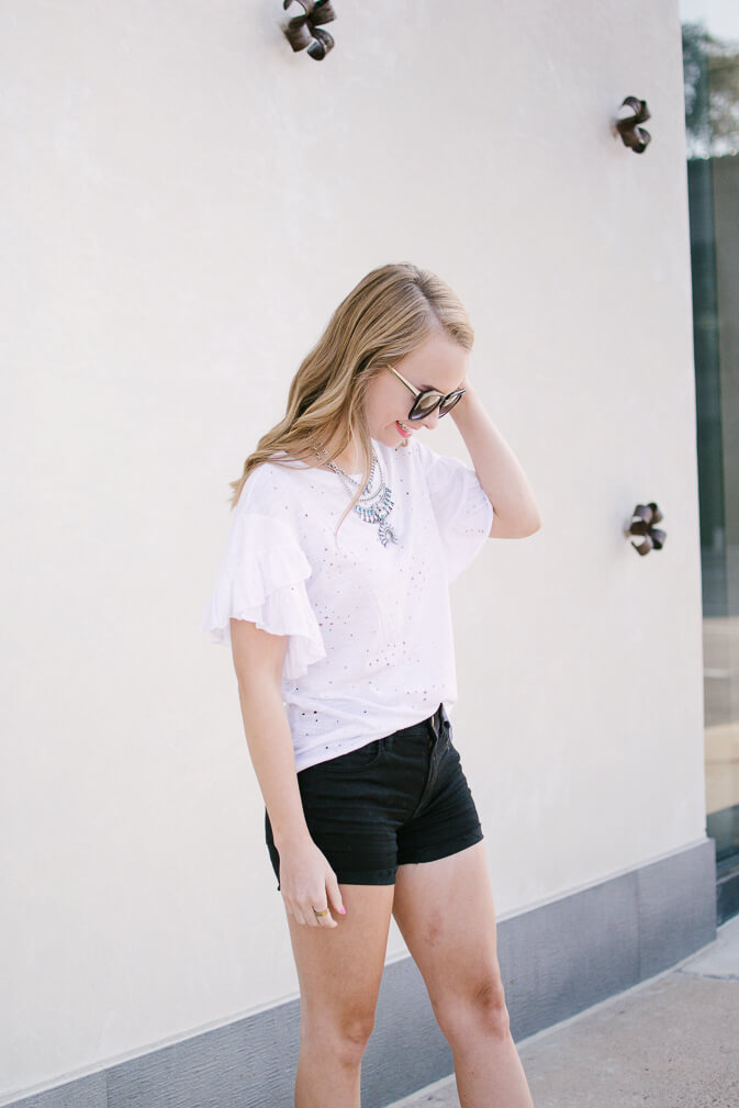 Cutest ruffle distressed tee for under $40 - click through to shop it and everything else you see! I have been on the hunt for a good basic distressed tee and think I have found a keeper. Such a great price point for this distressed tee & perfect to throw on and go | The Blonder Life